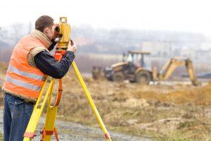 Land surveyor construction site