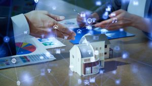 smart technology icons overlaid on small house model and hands of people talking